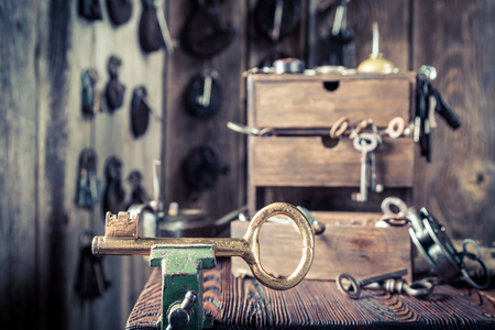 Locksmiths workshop with aged tools, locks and keys