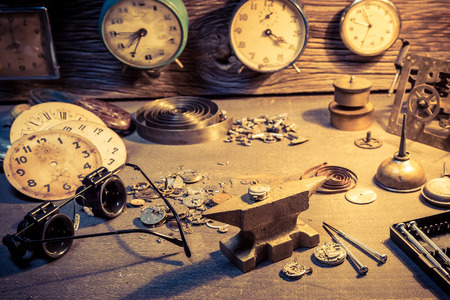 Old workshop with parts of clocks and tools Stock Photo