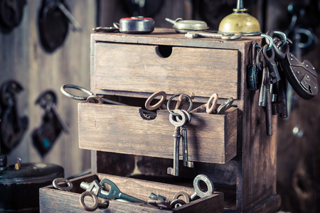 Ancient tools and spare parts in old locksmiths workshop Stock Photo