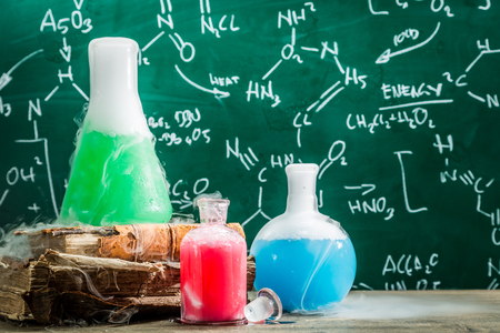 Testing chemical formula in school laboratory with books