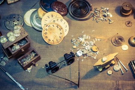 Vintage watchmakers workshop full of clocks and tools Banco de Imagens