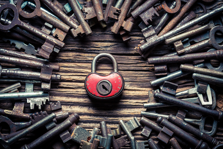 One red lock and many old keys as concept Stockfoto - 100136522