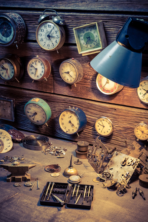 Vintage watchmakers workshop with clocks and tools Stock Photo