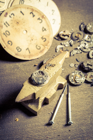 Aged watchmakers workshop with watch to repair