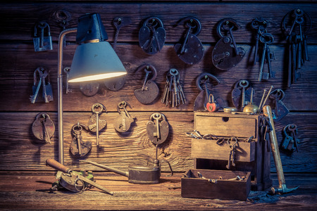 Old tools, locks and keys in locksmiths workshop Stock Photo