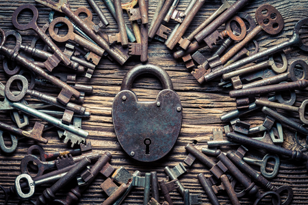 Many vintage keys and one lock as concept
