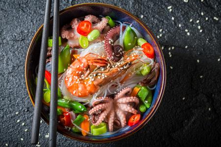 Closeup of seafood noodle on black rock Reklamní fotografie
