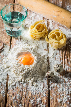 Fresh ingredients for homemade pasta with eggs and flour