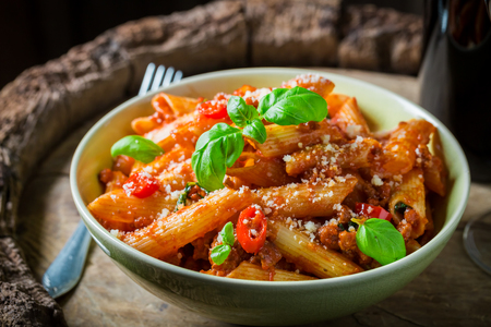 Delicious penne bolognese with red wine and parmesan