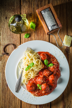 Enjoy your pasta bolognese with parmesan and meatballs