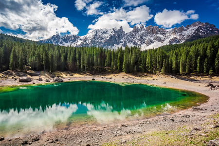 Green mountain Carezza lake in spring, Alps, Italy Stock Photo