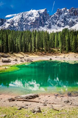Stunning mountain Carezza lake in Dolomites, Italy