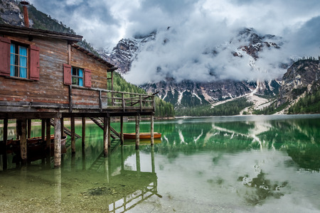 Stormy clouds over Pragser Wildsee lake in Dolomites, Europe