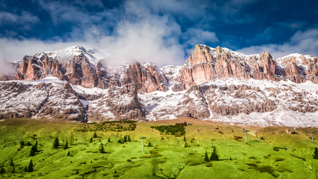 Breathtaking view to valley in snowy Dolomites in spring, Italy