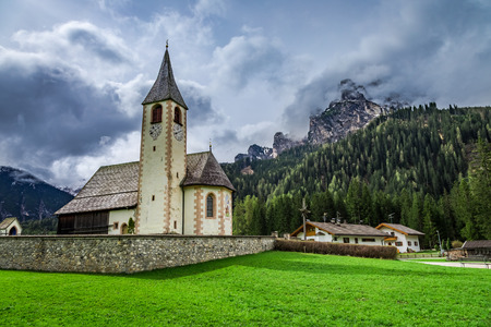 Small church in the dolomites in spring, Alps, Italy