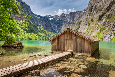 Wooden hut on Obersee lake, Alps, Germany Stock Photo