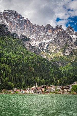 View of small town by the lake in spring, Dolomites