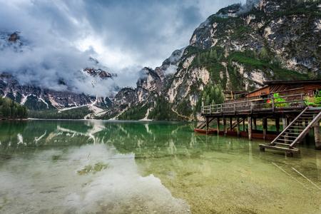 Hazy view of Pragser Wildsee lake in Dolomites, Europe