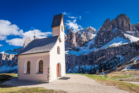 Path to church at Passo Gardena in spring, Dolomites, Italy