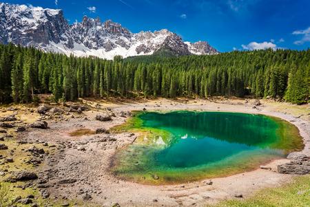 Bllue mountain Carezza lake in spring, Alps, Italy Stock Photo