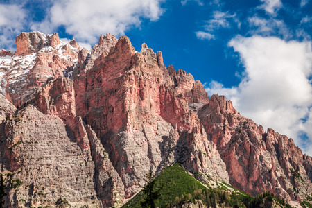 View to red mountain in Dolomites in spring, Italy Stok Fotoğraf - 101204955