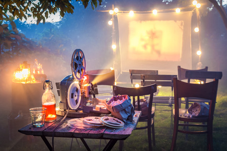 Small cinema in the summer garden in the evening
