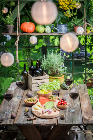 Evening in summer garden with wine and fruits