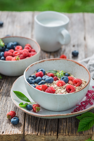 Closeup of healthy granola with fruits for breakfast