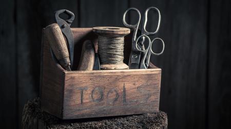 Retro small box of tools in wooden workshop Foto de archivo - 101669100