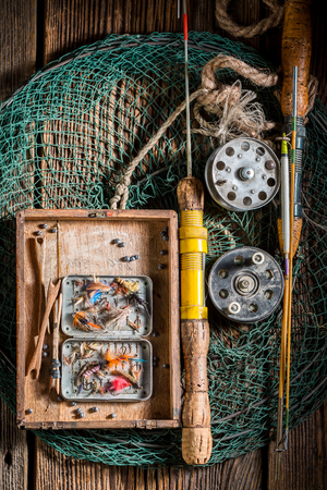 Top view of fishing tackle with flies, floats and rods 版權商用圖片