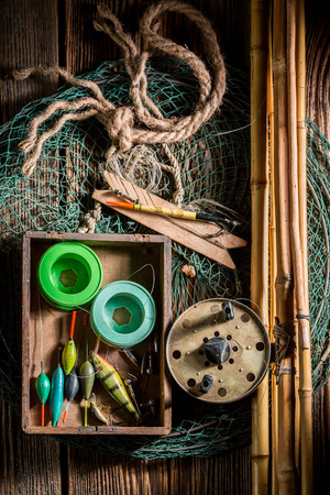 Old equipment for fishing with rods, net and floats