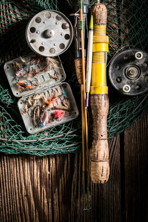 Top view of old fishing tackle with rod and lures Banco de Imagens