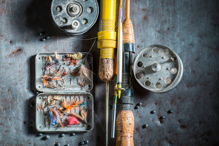 Equipment for fishing with hooks and rods on metal table Stock Photo