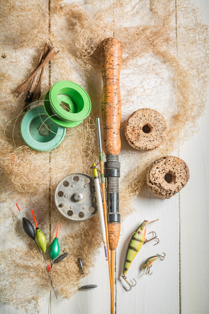 Tackle fishing with floats, rods and hooks on white table Stock Photo