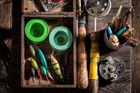 Closeup of fishing tackle with floats, hooks and rods Foto de archivo