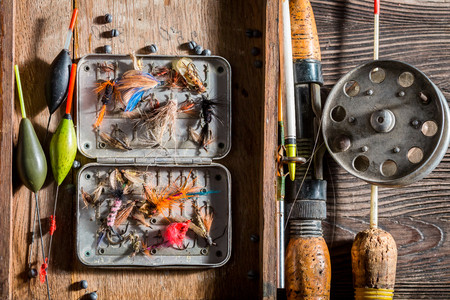 Closeup of vintage fishing tackle with net and rods