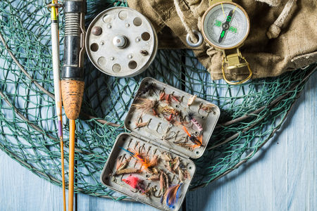 Equipment for fishing with compass, rods and backpack