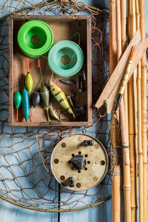 Old and handmade fishing for equipment with rods and floats 스톡 콘텐츠