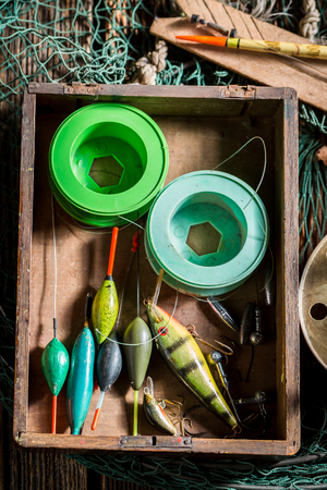 Closeup of vintage fishing tackle with fishing rod and lures
