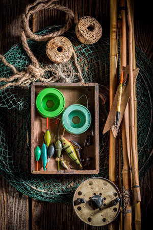 Vintage angler equipment with rods, net and fishing flies