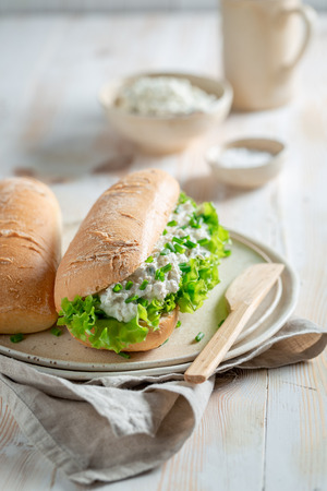 Healthy sandwich with creamy cheese, chive and lettuce
