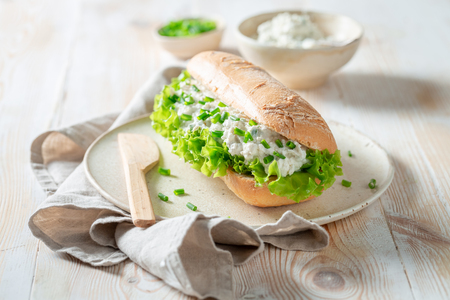 Fresh sandwich with crunchy bread, fromage cheese and chive