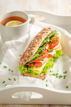 Fresh sandwich with ham, cheese and tomato for breakfast