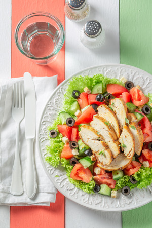Healthy Caesar salad with tomatoes, cucumber and chicken