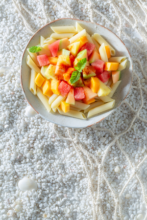 Sweet penne with melon, pineapple and papaya Stock Photo