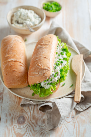 Healthy sandwich with crunchy bread, fromage cheese and chive