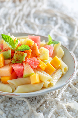 Delicious penne with melon, papaya and pineapple