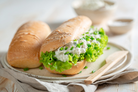 Fresh sandwich with creamy cheese, chive and lettuce