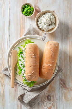 Spring sandwich with crunchy bread, fromage cheese and chive