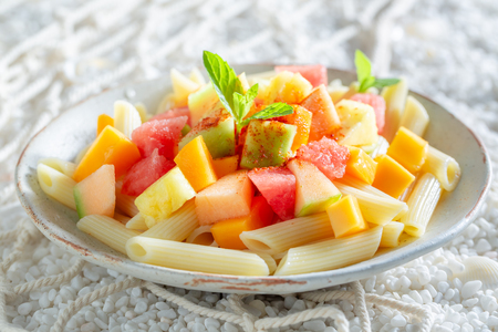 Tasty penne with melon, pineapple and papaya